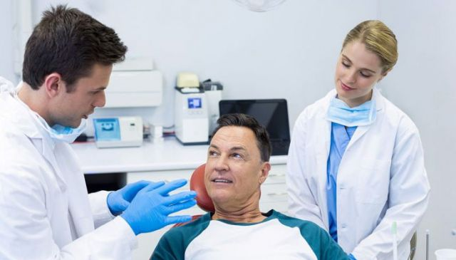 Doctor and nurse speaking to patient - Oral Cancer Biopsy Benicia CA,